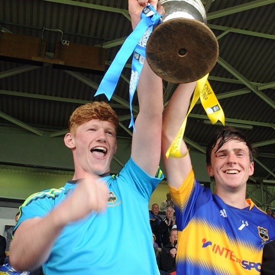 Stephen Quirke and Darragh Peters lift the TWA Cup after Tipperary won the Munster Minor Hurling Final